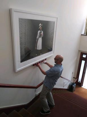 Mark installing a rare photo — provided by San Francisco Art Exchange and RL Figures