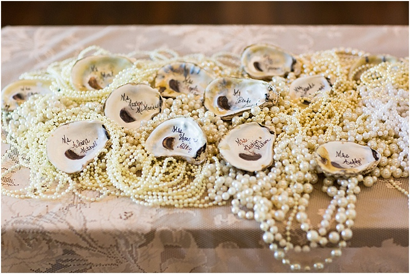 grace and serendipity, ashley victoria photography, fiore  - the lacy oyster - pearls and oysters as placecards, with pink lace tablecloth