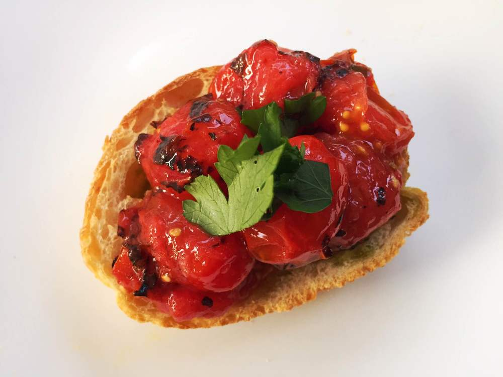 I challenge you to find a better piece of bruschetta. The charred tomatoes are everything.