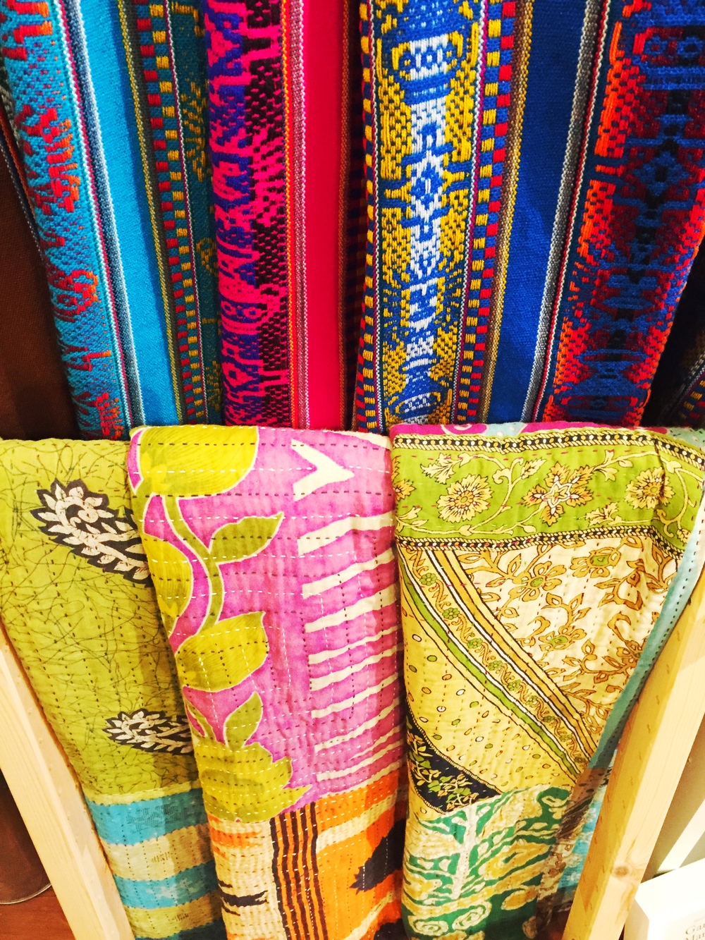 I have my eye on one of these beautiful reversible sari throws.