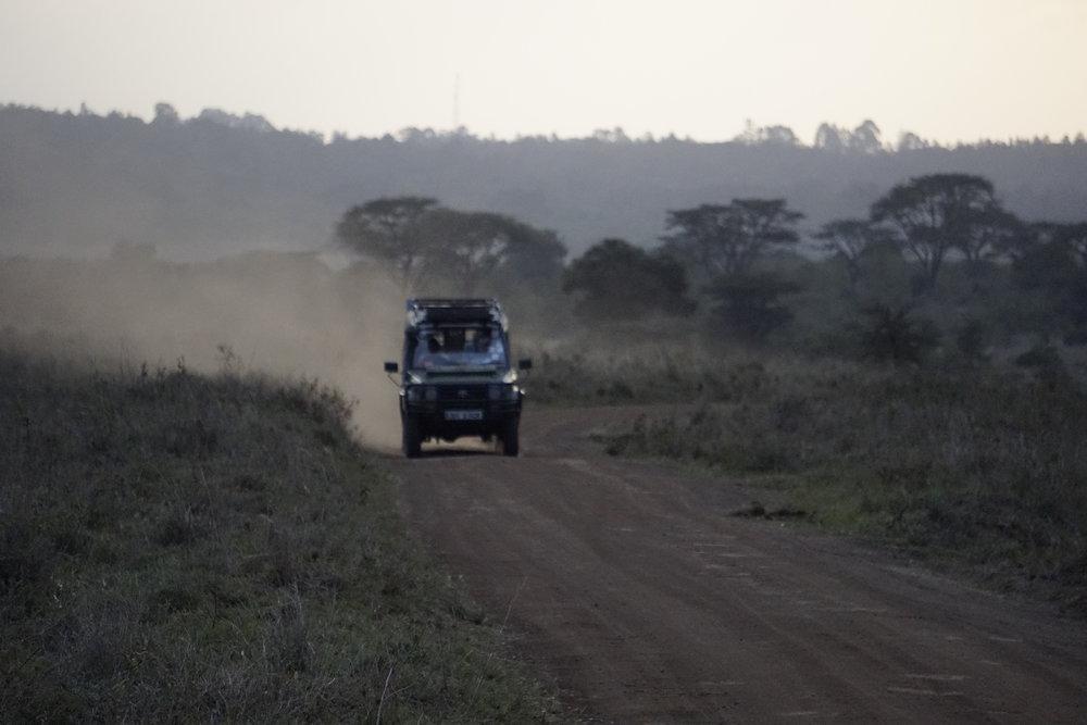 Nairobi National Park 97 (Car at Sunset).JPG