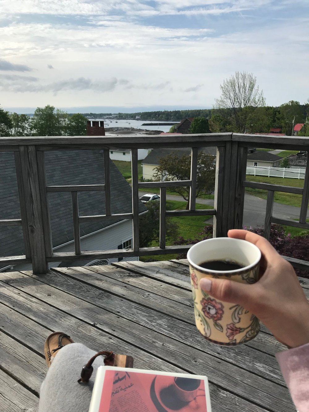 Enjoying a book, coffee, and the view before breakfast at the Kingsleigh Inn, Southwest Harbor, ME