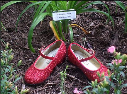 Decorative red shoes in their Garden of Oz