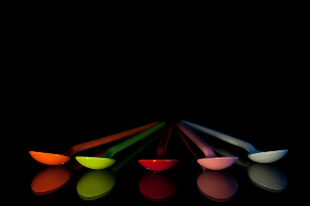 picture of spoons on a dark background - Spoon theory for invisible illness