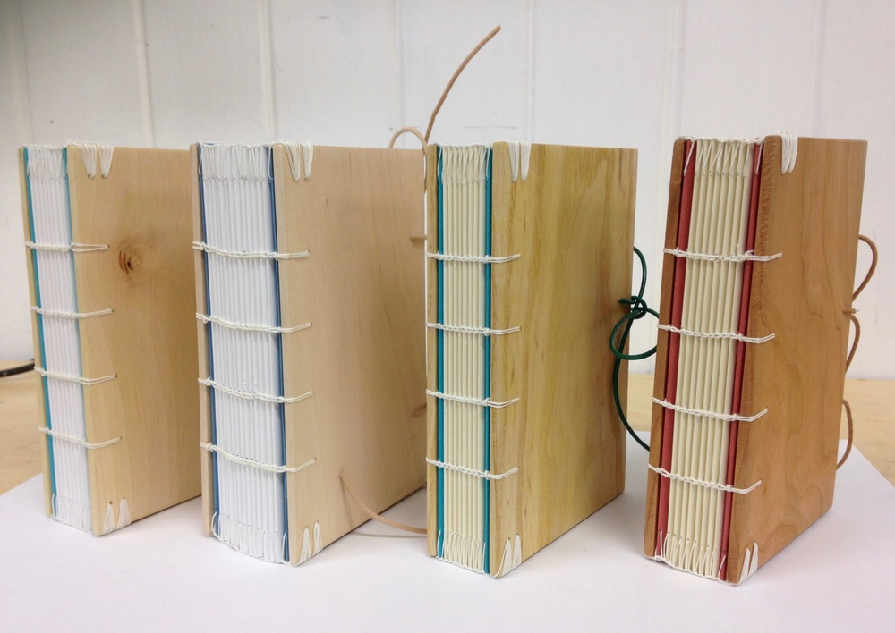 Books made on a short course at West Dean College, using wooden boards with exposed sewing, based upon Coptic binding methods.