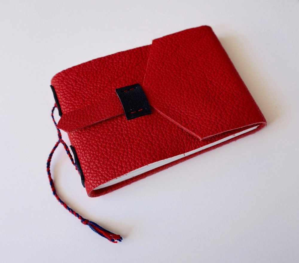Another small pocket book with a leather cover.