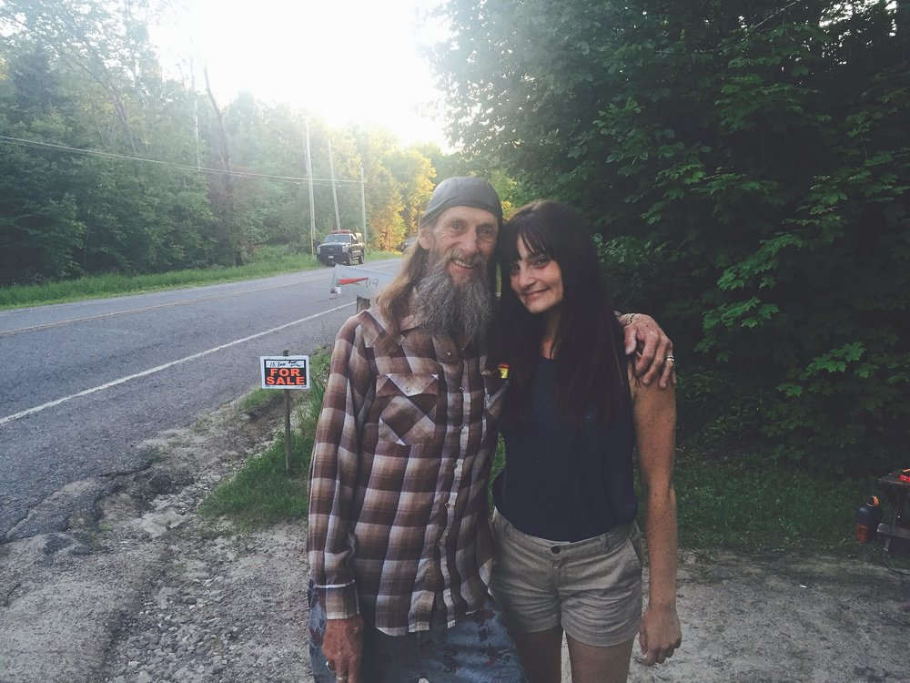"Chelsia and ""Slim"" — who is known in Malone by this nickname — stand in Slim's driveway off of Fayetteville Road in Malone, N.Y. on the day Richard Matt was shot and killed. Law enforcement descended upon the area right in front of Slim's house, establishing a tight perimeter in hopes of catching David Sweat.  (Michael McCaffrey/June 26, 2015)"