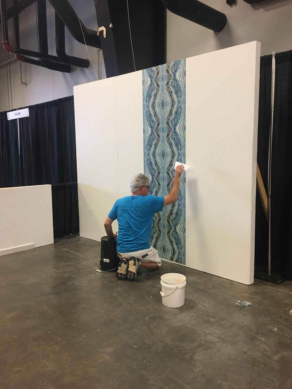 We had wall built to surround our booth and had this amazing  Eykon  wallpaper installed. It made such a bold statement & the installation was complete in about an hour!