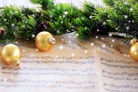 57510347-christmas-decorations-on-music-sheets-with-snow-effect.jpg