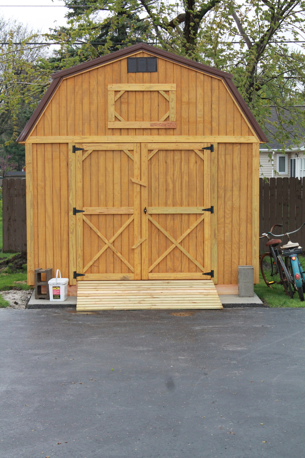 pressure treated lofted barn with metal roof delivered to customer..JPG