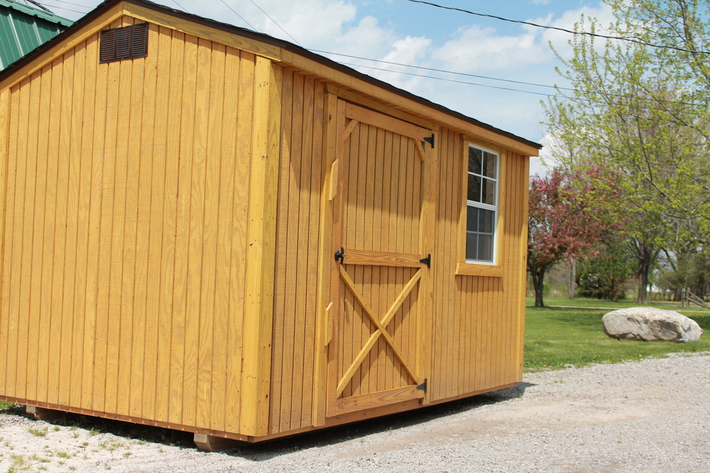pressure treated garden shed with shingled roof.JPG