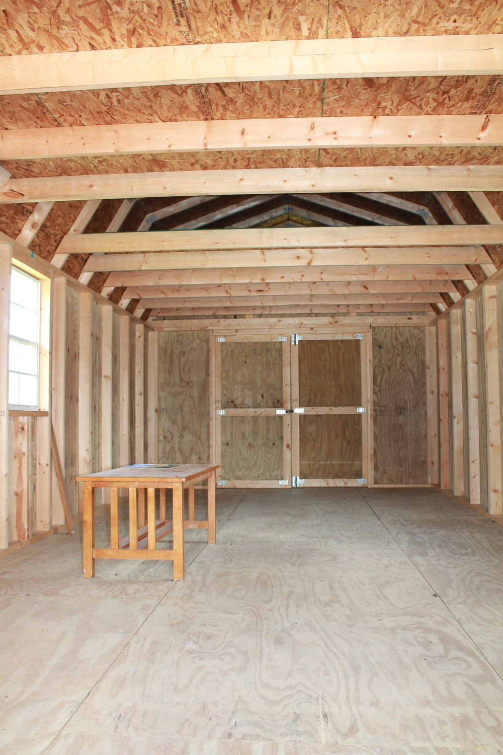 interior of pressure treated cabin with covered front porch.JPG
