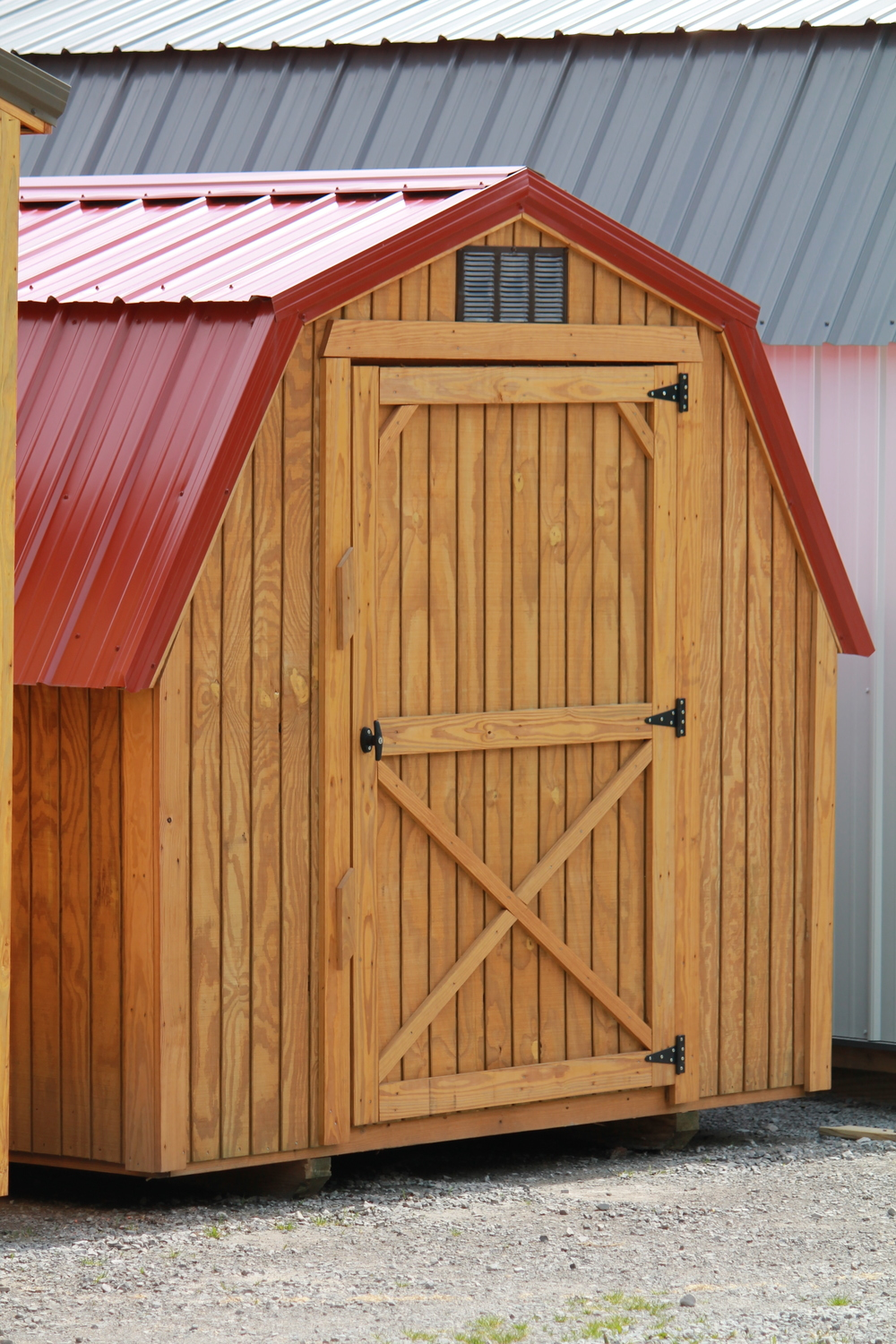 pressure treated barn with a metal roof.JPG