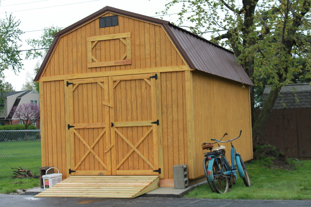 pressure treated lofted barn with metal roof delivered to customers home.JPG