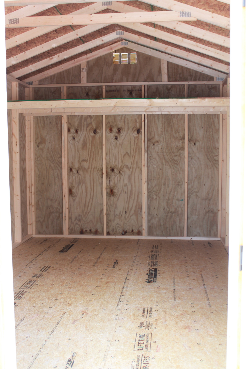 interior of pressure treated utility shed with the additional height option which then adds a small loft area.JPG