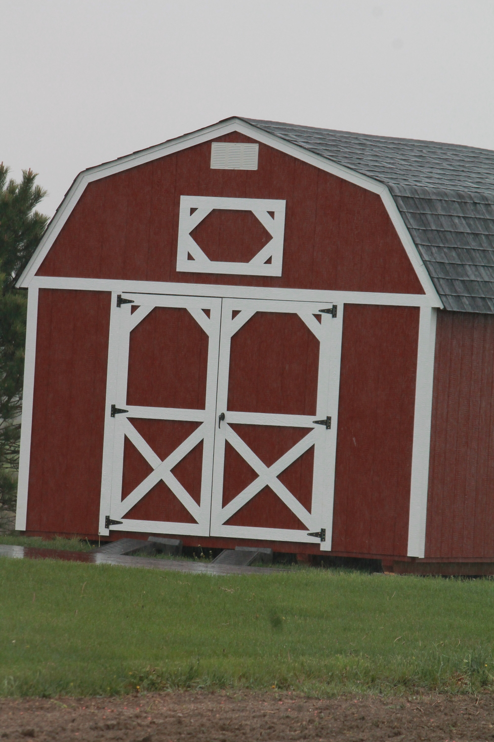 painted pressure treated lofted barn with shingled roof delivered to customer.JPG