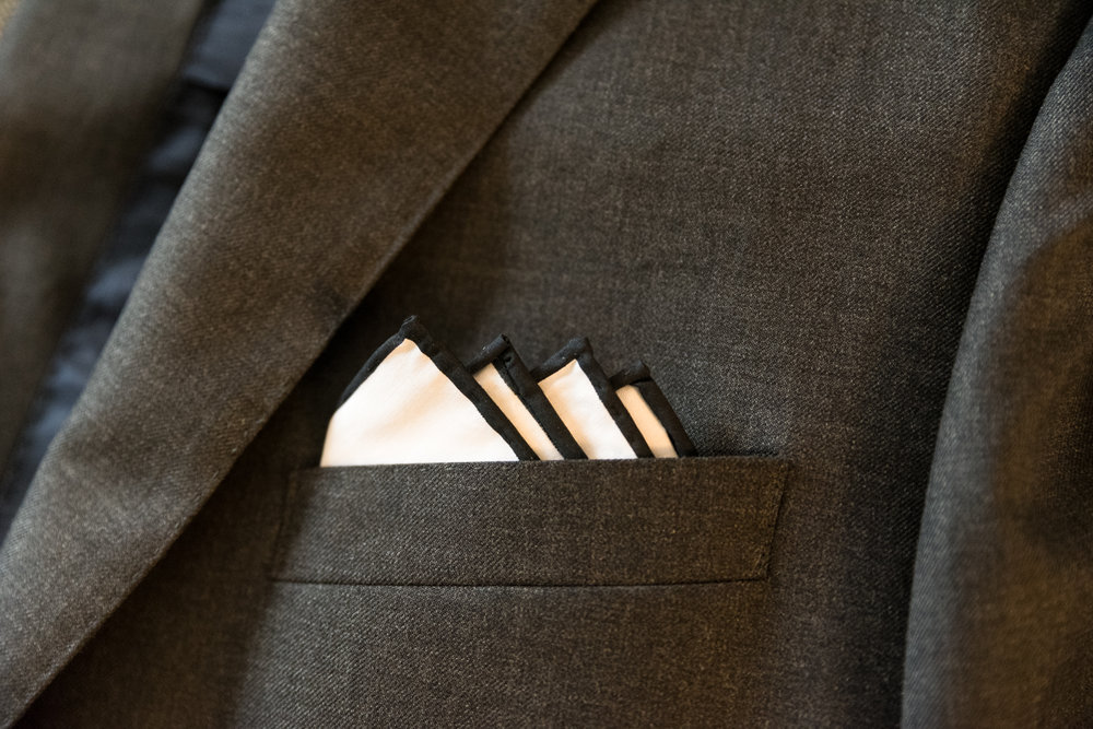 YOUR SUIT - Is this a black tie event, or flip flops on the beach? Are there funny socks under your tux pants? Or customized cuff links? A bowtie or suit tie? The groom's attire showcases his personality as well.