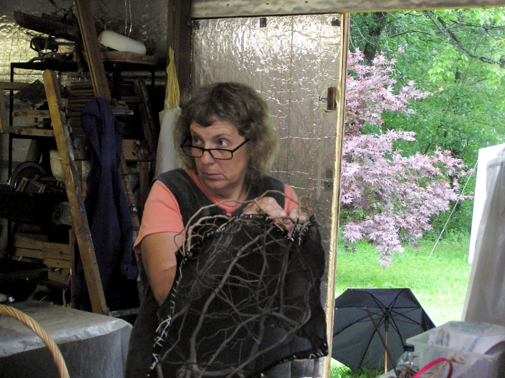 Bonnie applying cloth to her willow armature.