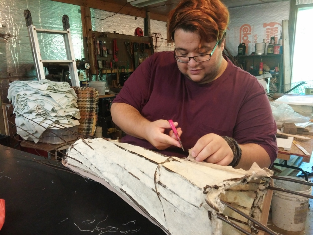 Tony removing the cloth from his handmade paper sculpture.