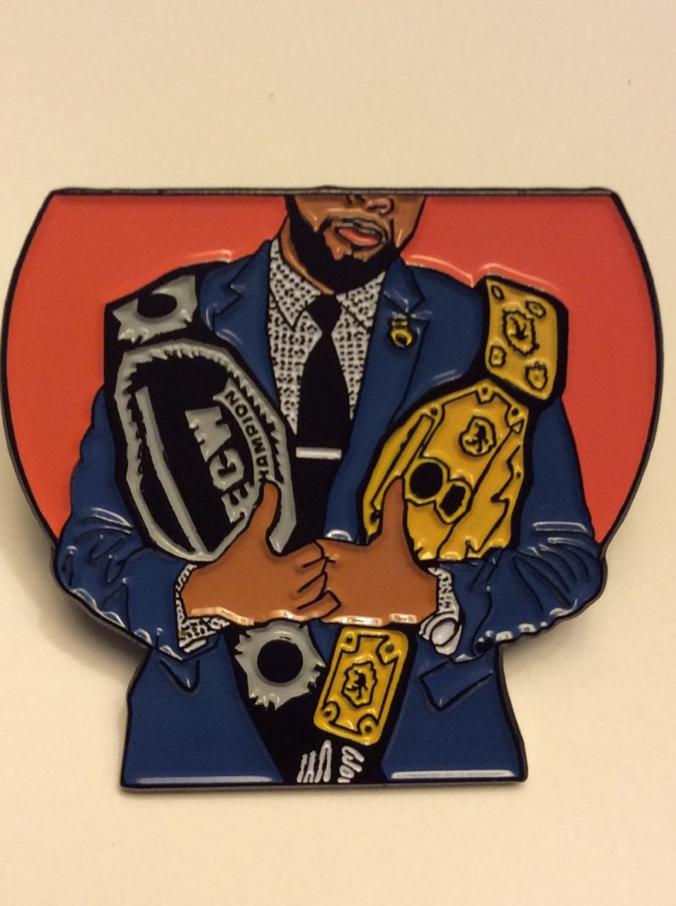 Your boy has been immortalized as a lapel pin.