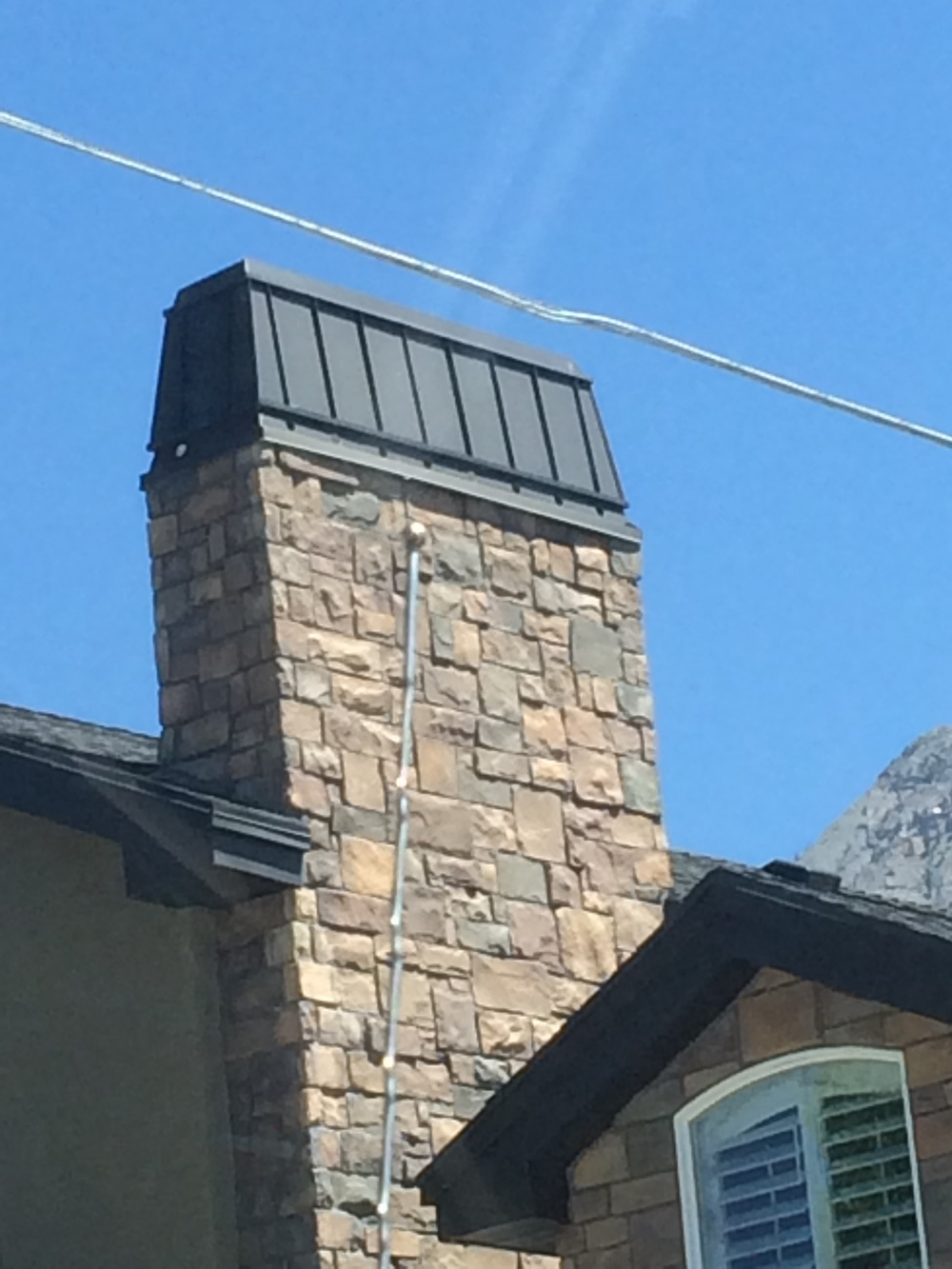 rooftop-accent-stone-and-chimney-cap.jpg