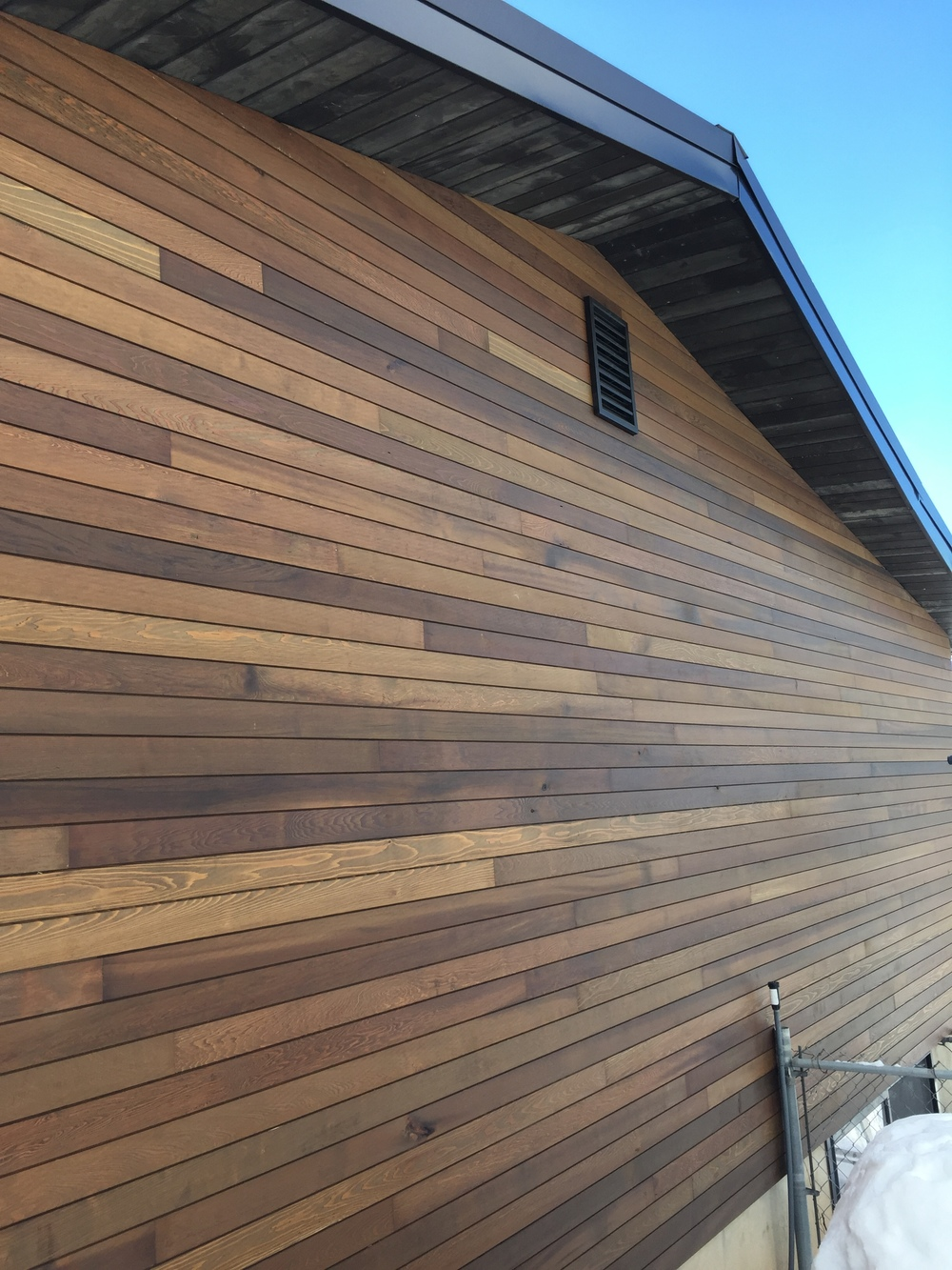 Cedar siding with tongue and groove soffits