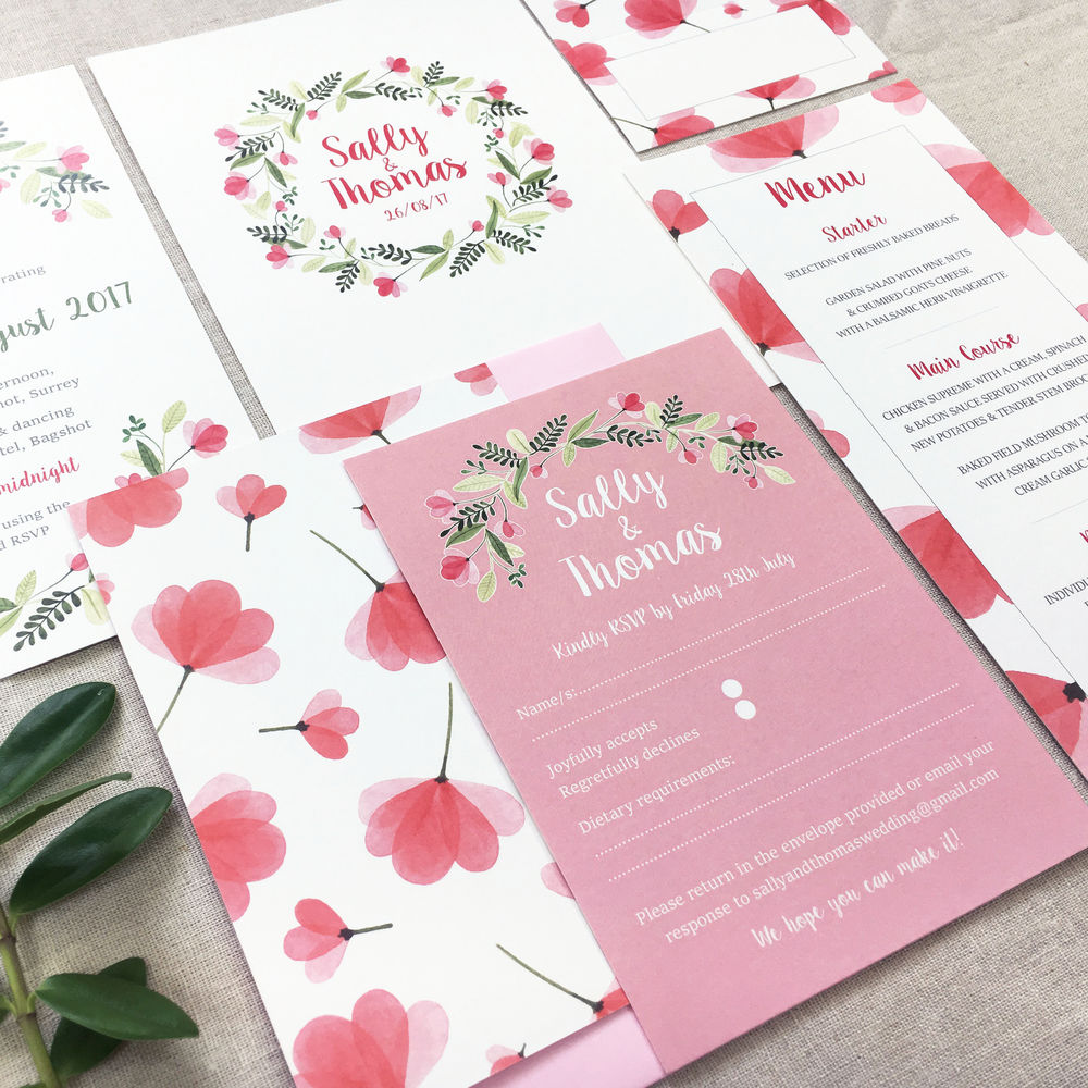 FLEUR    A bright and pretty design, with a beautiful pink and green watercolour garland, framing all the details of your special day. This lovely suite would suit a spring/summer wedding day perfectly!