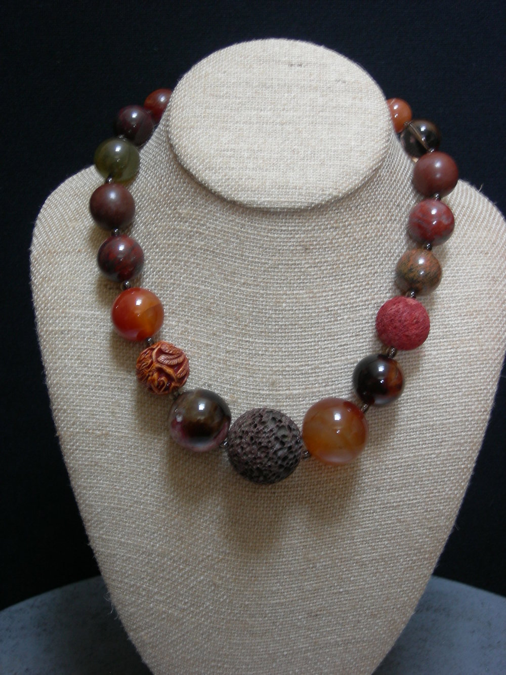 "Various semi-precious stones with sterling clasp.  18.5""   $90"