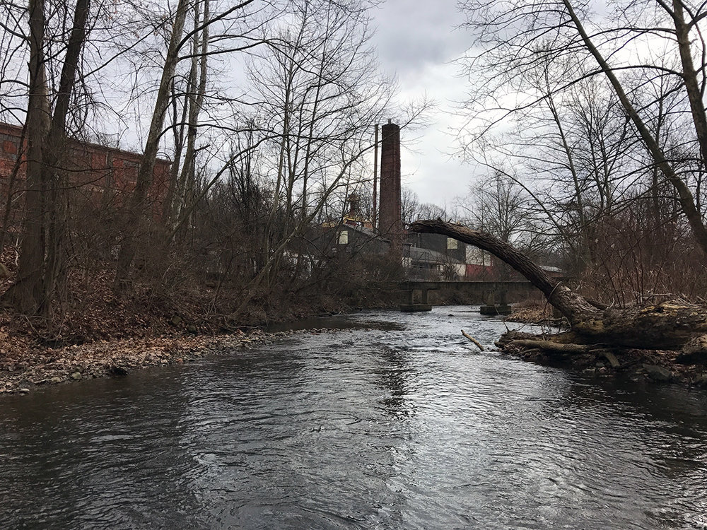 Foreboding smokestacks rise above the landscape on the Monocacy Creek.
