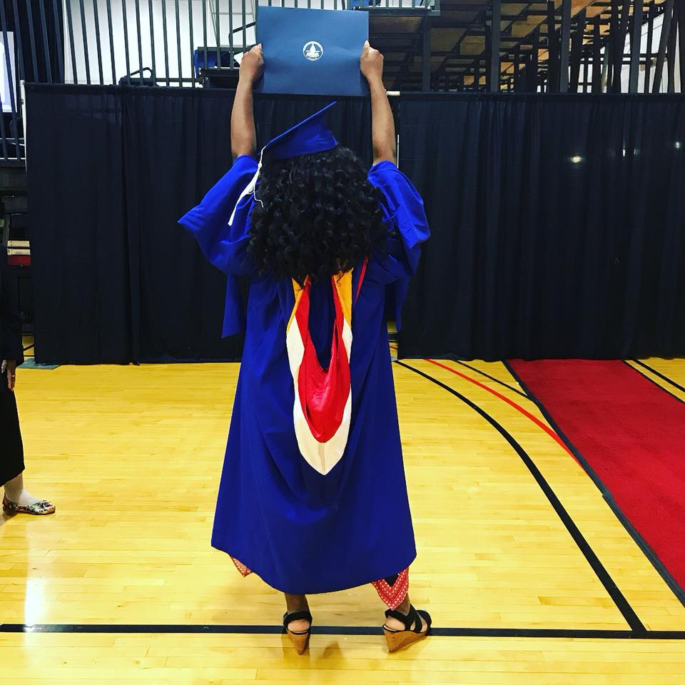 Yaasss!!! I did it! Me holding up my placeholder diploma after the ceremony.
