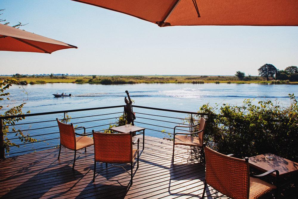 NATURAL BORDER  ::  The patio furniture sits firmly in Botswana, while the opposite grassy riverbank grows in Namibia.Chobe Safari LodgeKasane, Botswana