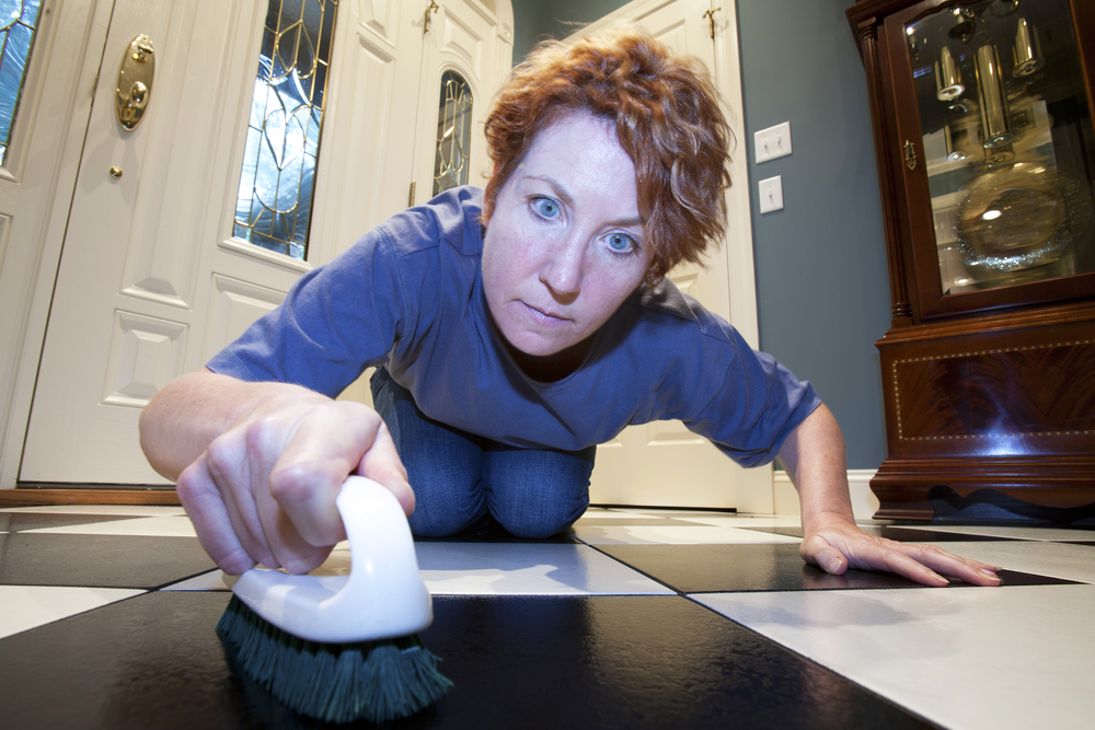 an adult female with obsessive compulsive disorder obsessively cleaning floor