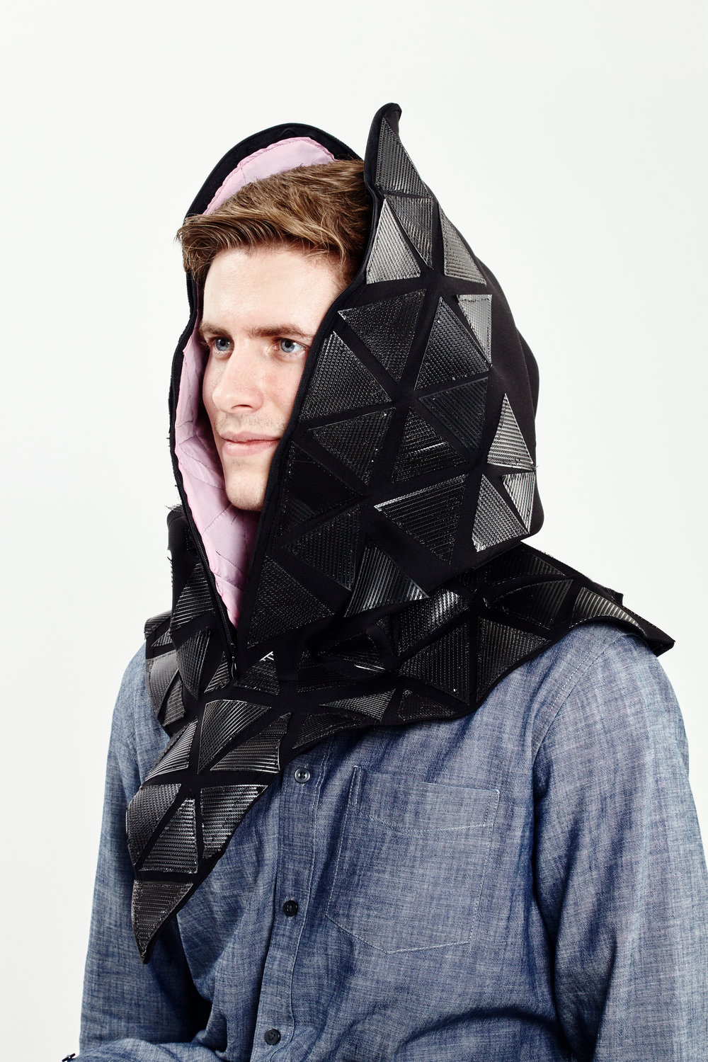 It addresses the current social norm of being constantly connected to technology. The garment is designed with neoprene fabric that insulates and protects the wearer from the outside world, and a mylar cell phone pocket that blocks cell signals.