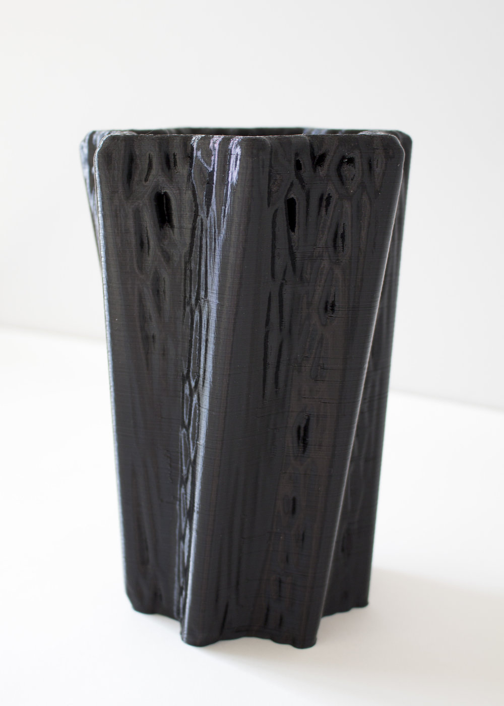 The web pattern on the vase was created using the Voronoi diagram to fracture the flat surface into an organic flowing surface.