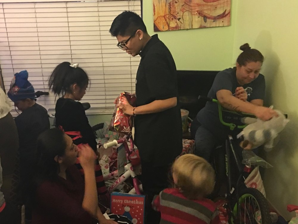 The children were very excited to begin opening their presents.