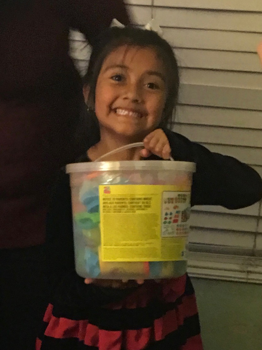 She is very happy with her bucket of chalk.
