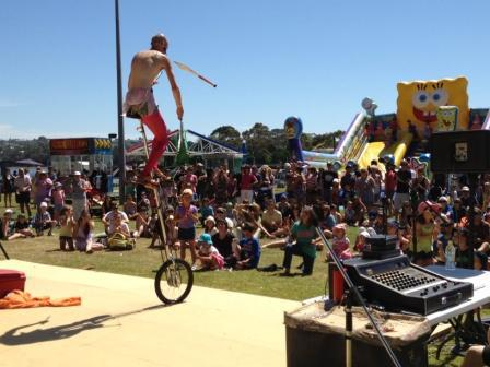 Unicyclist Juggler showing us his skills with long knives