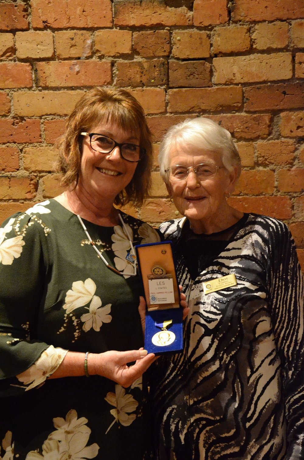 Julie Jacobson (left) proudly taking on the presidency of the Rotary Club of Ulverstone West, whilst acknowledging her late father who was a charter member and a Paul Harris Fellow. Julie's mum, Dot Coates, an honorary member, was also there to celebrate.
