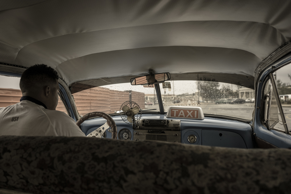 Inside of our taxi from Jose Marti International Airport to La Habana Vieja.