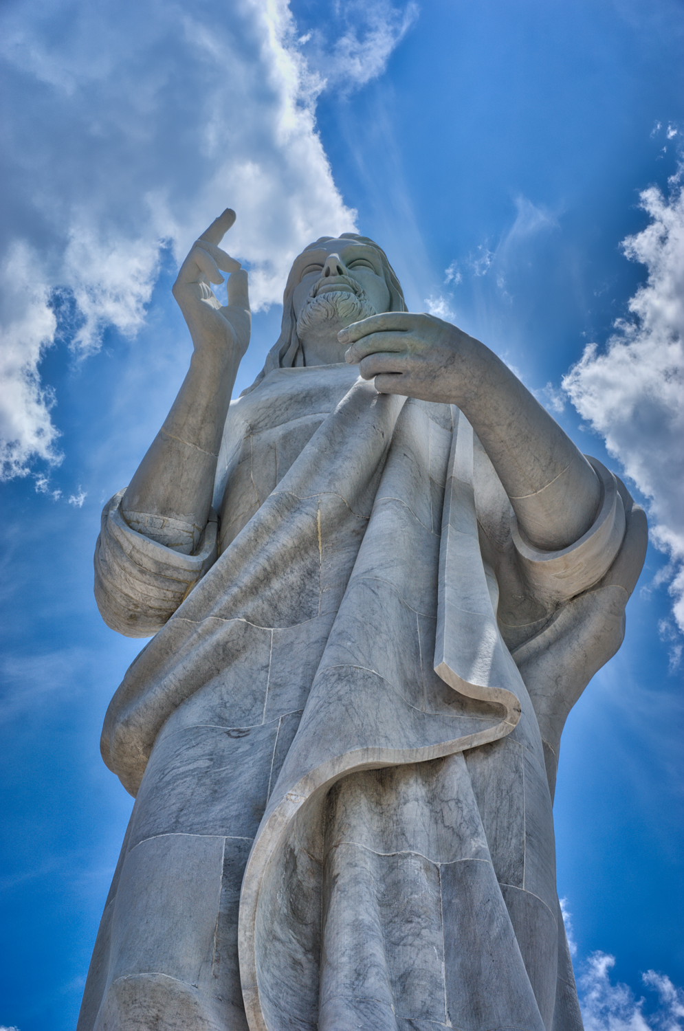 Cristo de La Habana statue by Jilma Madera. It's about 20 meters tall, located in a suburb called Casablanca,and overlooks the city of Havana. There are little gift shops near by to purchase cards and jewelry. Also across the street is La Cabana de Che, his headquarters building.