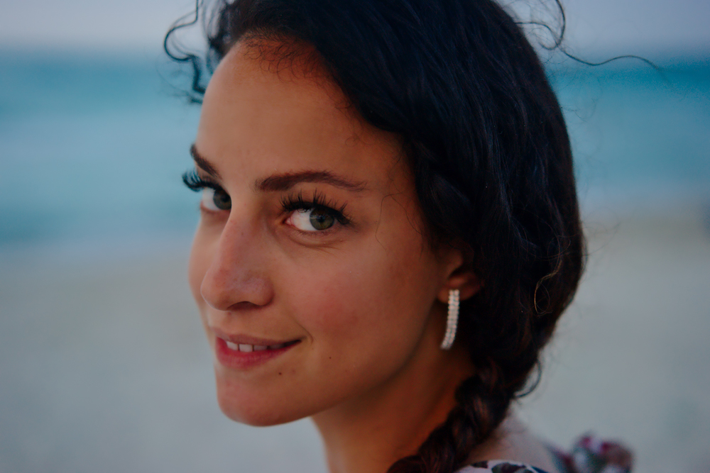 Portrait of Katie on beach.