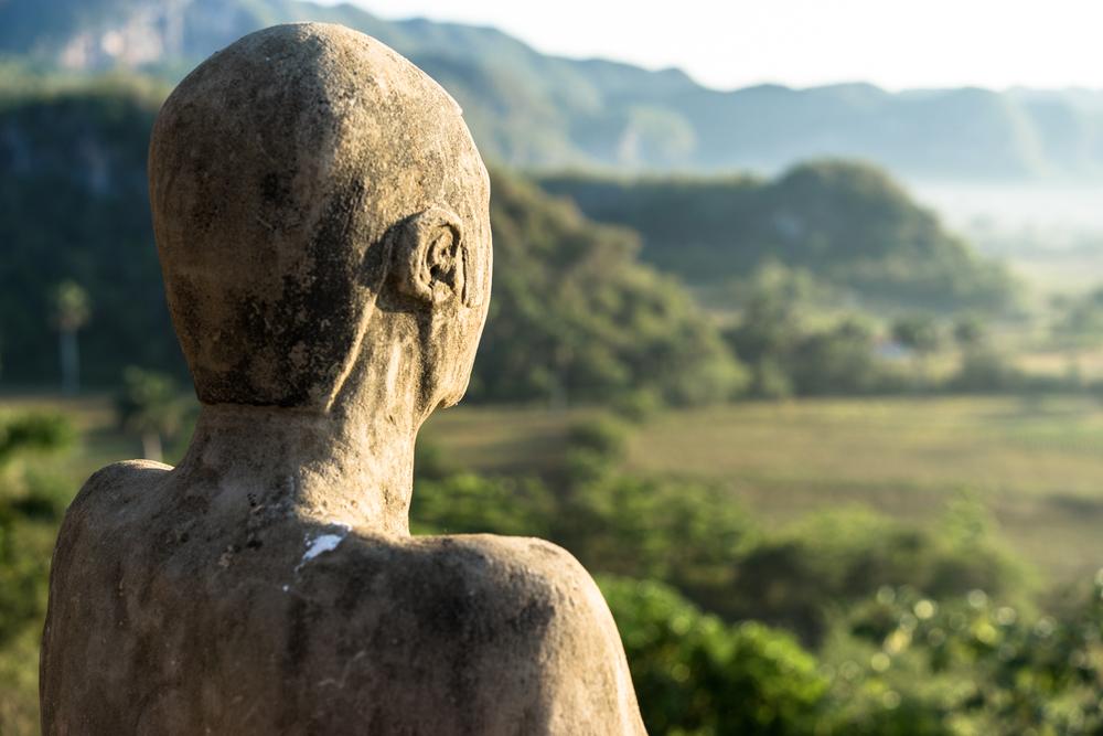 Statue overlooking the sunrise in Vinales, Cuba.