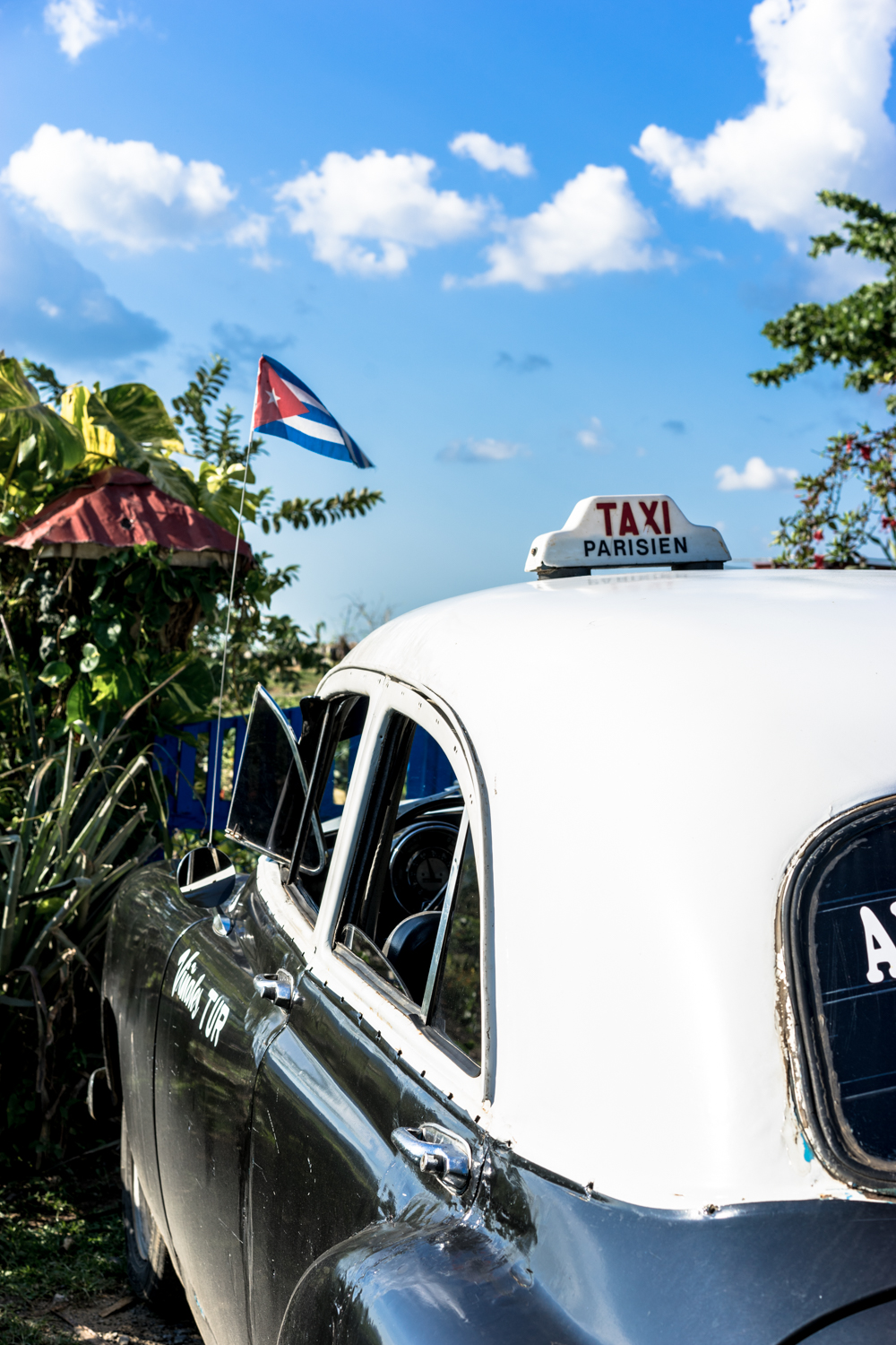 Cuban taxi parked outside of the Finca Agroecologica El Paraiso restaurant.