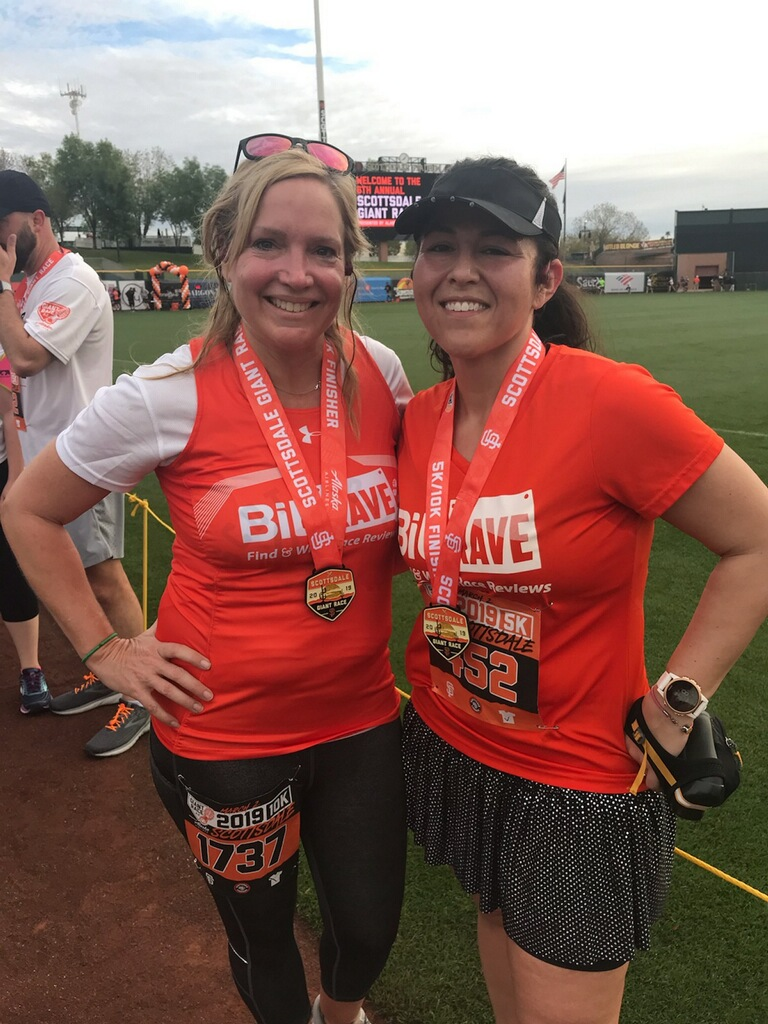 Emily waited for me at the finish line! She ran the 10k and I the 5k. Check us out representing BibRave! Go team Orange!