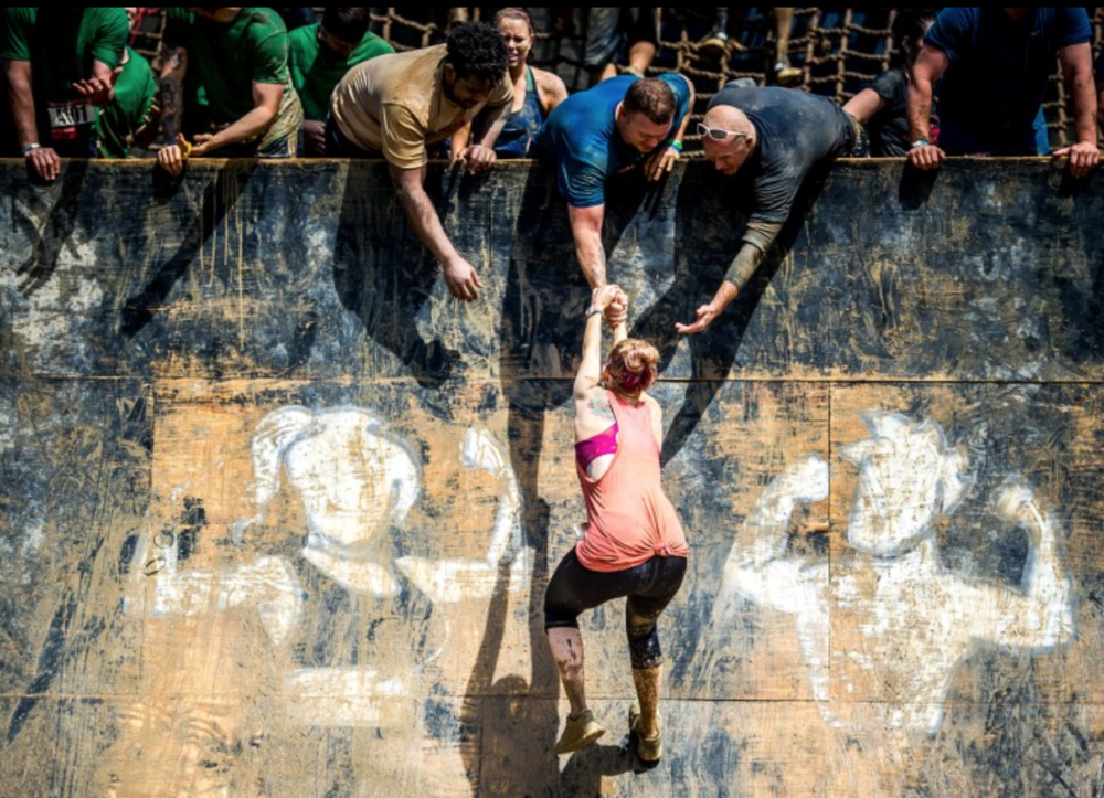Rugged Maniac races are more like camaraderie events. Strangers are there to help each other.
