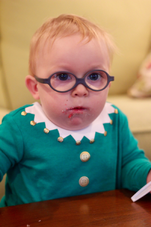 Little boy in elf outfit with shocked look on his face