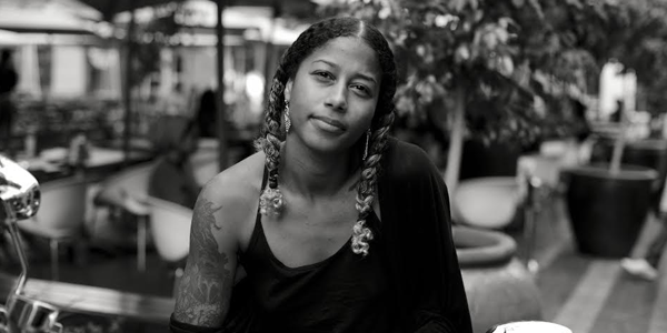 "The youngest individual to win the legendary Nuyorican Poet's Café Grand Slam title—Aja Monet is a Caribbean-American poet & educator from East NY, Brooklyn. A graduate of Sarah Lawrence College, she received her BA in Liberal Arts and was awarded the The Andrea Klein Willison Prize for Poetry established to recognize poetry that ""effectively examines relationships among women, especially in the context of justice for everyone."" She received an MFA in Creative Writing from the School of the Art Institute of Chicago. Aja Monet independently published her first book of poetry, The Black Unicorn Sings (2010). In 2012, she collaborated with poet Saul Williams on a poetry anthology of this generation's social and political anthems entitled, Chorus: A Literary Mixtape (MTV Books/Simon & Schuster). In 2014, Aja Monet was awarded the YWCA of the City of New York's ""One to Watch Award""—an award established in honor of Monet's work: for women under the age of 30 who exemplify the mission to empower women and eliminate racism. She was an active member of Justice League NYC, a rapid response organization created by Harry Belafonte's Gathering for Justice, a movement to end youth incarceration and to eliminate the racial inequities in the criminal justice system. Co-founder of Smoke Signals Studio, Aja Monet currently lives in Little Haiti, Miami and volunteers to merge arts & culture in community organizing with the Dream Defenders and Community Justice Project. She spearheaded an arts & activism initiative, ""Voices: Poetry for the People"" that provides free poetry workshops for grassroots leaders & organizers in Florida. As well she continues to organize artist delegations, cultural, and political exchanges with disenfranchised communities at home and abroad. Her first full collection of poems is forthcoming in May 2017 on Haymarket Books entitled, ""my mother was a freedom fighter."""
