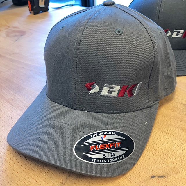 Custom hats, beanies and storefront decals for a local engineering firm! How can Grandline serve you?