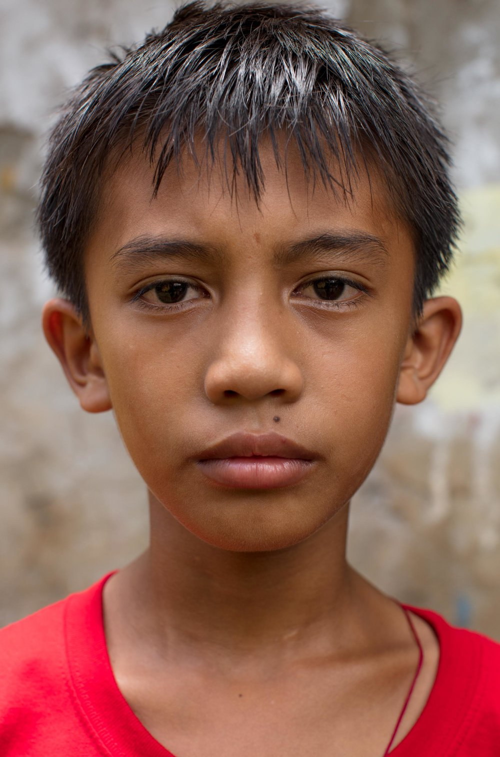 My name is Christian and I'm 11 years old. I live in a small shack with my family. My Father is a fisherman and my Mother stays home because she has a mental illness. Sometimes we don't eat, especially if its not good weather and my Father can't catch fish. My Father took over all responsibilities in the family because my Mother cannot help him. We are all very sad about her and it makes me cry when I see my Mother talking to herself. I'm so scared that I will be sad and stressed and I will not be able to keep pursuing my studies. I feel so lonely. I want to see my family happy because that will make me happy and I hope that my Mother gets better.