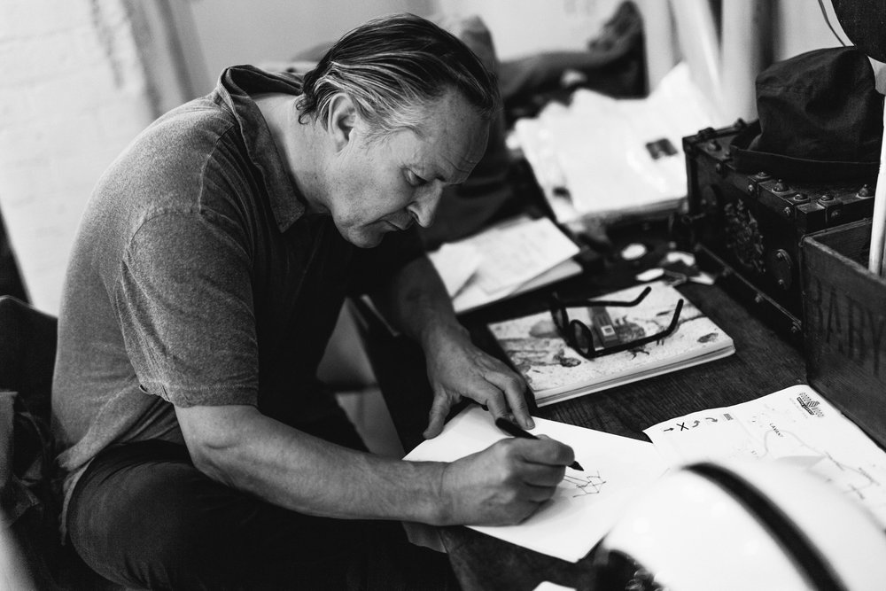 Nick Ashley drawing fashion sketches